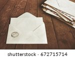 open envelope on a wooden table | Shutterstock . vector #672715714