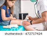 medical female doctor bandaging ... | Shutterstock . vector #672717424