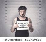 caught gangster in jail with... | Shutterstock . vector #672719698