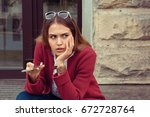 sad girl waiting for a mobile... | Shutterstock . vector #672728764