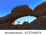 Young Couple At Stone Arch Of...