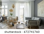 living room with round table ... | Shutterstock . vector #672741760