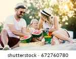 happy family is enjoying beach... | Shutterstock . vector #672760780