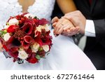 hands of the newlyweds with a... | Shutterstock . vector #672761464