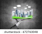 waiter presenting on tray urban ... | Shutterstock . vector #672763048