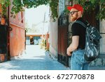Small photo of Beautiful ginger bearded man in red peaky cap