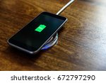 smartphone charging on a... | Shutterstock . vector #672797290
