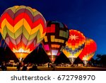 four hot air balloons preparing ... | Shutterstock . vector #672798970