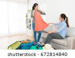 young beautiful girl packing... | Shutterstock . vector #672814840