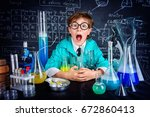 smart boy scientist making... | Shutterstock . vector #672860413