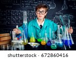 smart boy scientist making... | Shutterstock . vector #672860416