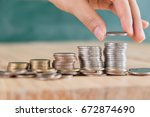 hand put coin to money ... | Shutterstock . vector #672874690