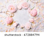 pink cupcakes with roses and... | Shutterstock . vector #672884794