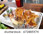 roasted pork knuckle on white... | Shutterstock . vector #672885574