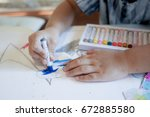 kid hand color paining  | Shutterstock . vector #672885580