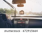 business man is driving a car... | Shutterstock . vector #672915664