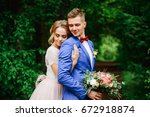 embracing bride and groom at... | Shutterstock . vector #672918874