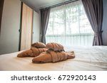 towels on bed | Shutterstock . vector #672920143