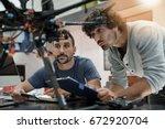engineer and technician working ... | Shutterstock . vector #672920704