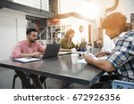 trendy young people working in... | Shutterstock . vector #672926356