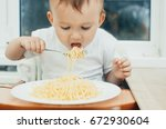 the child eagerly eats... | Shutterstock . vector #672930604