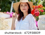 Beautiful Women In A Straw Hat...