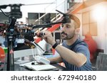 engineer working on drone in lab | Shutterstock . vector #672940180