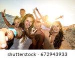 group of happy teenage friends... | Shutterstock . vector #672943933