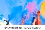 hands up on color holi festival  | Shutterstock . vector #672946390