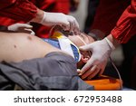 paramedics rescue the victim of ... | Shutterstock . vector #672953488
