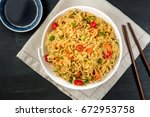 a bowl of instant chinese... | Shutterstock . vector #672953758