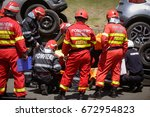 Small photo of Rescue firefighters and paramedics take part in a vehicle extrication at a drill car crash site