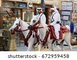 Small photo of DOHA, QATAR - JULY 6, 2017: Mounted police continue their leisurely patrols of the capital's Souq Waqif market during the diplomatic crisis between Qatar and neighbouring Arab states