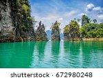 landmark of ratchaprapha dam ... | Shutterstock . vector #672980248
