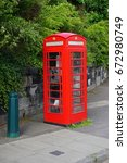 a classic vintage red british... | Shutterstock . vector #672980749