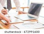 business team meeting present  ... | Shutterstock . vector #672991600