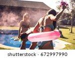 young people lighting smoke... | Shutterstock . vector #672997990