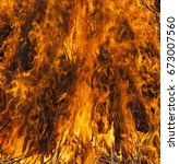 the raging flame close up.... | Shutterstock . vector #673007560