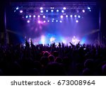 stage  concert light. people... | Shutterstock . vector #673008964