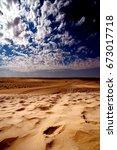 Dune In The Sahara Desert And...