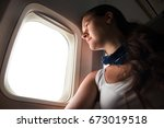 young woman looking through... | Shutterstock . vector #673019518