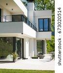 exterior of modern luxury villa | Shutterstock . vector #673020514