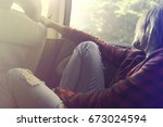 dreaming woman relaxes by car... | Shutterstock . vector #673024594