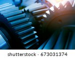 large cog wheels in the motor... | Shutterstock . vector #673031374