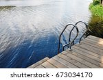 Wooden Pier With Metal Railing...