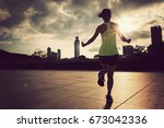young fitness woman jumping... | Shutterstock . vector #673042336