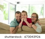 happy young family with little... | Shutterstock . vector #673043926