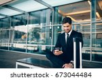 young businessman sitting on... | Shutterstock . vector #673044484