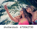 friends taking self portraits... | Shutterstock . vector #673062730