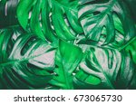 green tropical palm leaves... | Shutterstock . vector #673065730